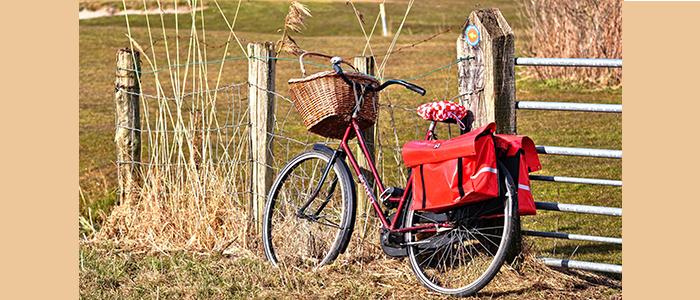 Länk till menygrupp Trafik & resor, med bild på en cykel